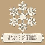 Paper snowflake frame and Season`s greetings Stock Images