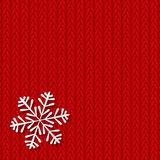 Paper snowflake on knitted background. Paper snowflake on red knitted background Royalty Free Stock Photos