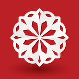 Paper snowflake on red. White paper snowflake on a red background Royalty Free Stock Photo