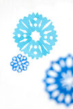 Paper snowflakes. Abstract Christmas background. Royalty Free Stock Photos