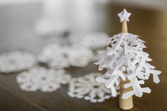 Paper snowflakes christmas tree on wood table Royalty Free Stock Images
