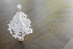 Paper snowflakes christmas tree on wood table Stock Image
