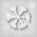 Paper snowflakes on gray background Royalty Free Stock Photography