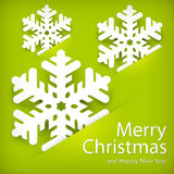 Paper snowflakes on green Stock Images