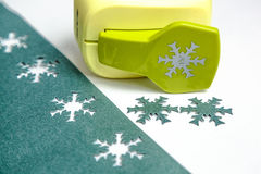 Paper snowflakes with hole punch Royalty Free Stock Images