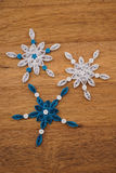 Paper snowflakes made with quilling technique Stock Images