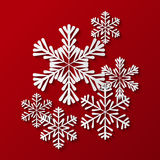 Paper snowflakes on red Royalty Free Stock Photography