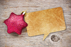 Paper speech bubble with Christmas bauble Stock Image