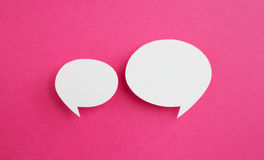 Paper speech bubble. On pink background Stock Photos