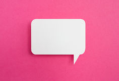 Paper speech bubble. On pink background Royalty Free Stock Photography