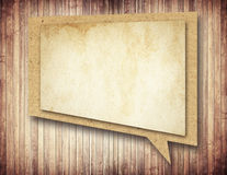 Paper speech bubble with shadow on brown wooden Royalty Free Stock Photography