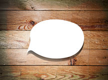 Paper speech bubble on wood background Stock Image