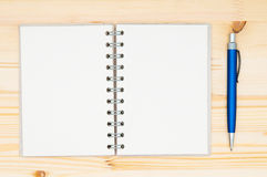 Paper spiral notebook and pen Royalty Free Stock Photos
