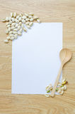 Paper with spoon and pistachios Stock Photo
