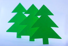 Paper spruces. Three green paper spruces on white background Royalty Free Stock Photos