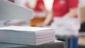 Paper stack in front of worker in the typography. Blurred stock footage