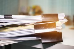 Paper stack, Pile of unfinished documents on office desk related Stock Images