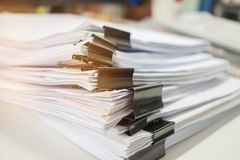 Paper stack, Pile of unfinished documents on office desk related stock photo