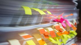 Paper stack, Pile of unfinished documents with post it on office Stock Images