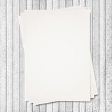Paper stacked on white wood texture Royalty Free Stock Photos
