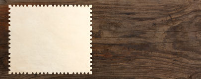 Paper stamp post old wooden table Royalty Free Stock Image