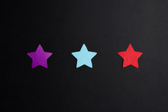 Paper stars of different colors Stock Photo