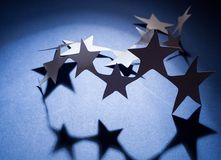 Paper stars group on a colour background Royalty Free Stock Photography