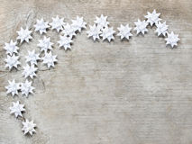 Paper stars on wooden rough background. Stock Photo