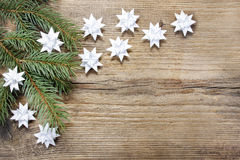 Paper stars on wooden rough background. stock image