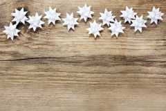 Paper stars on wooden rough background Royalty Free Stock Photos