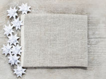 Paper stars on wooden rough background Royalty Free Stock Photo