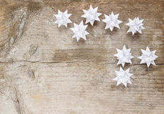 Paper stars on wooden rough background Stock Photography