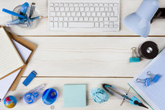 Paper, stationery and keyboard on wooden planks background Stock Photo