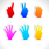 Paper stickers of color hands. Paper colored stickers of raised hands. Vector illustration Royalty Free Illustration