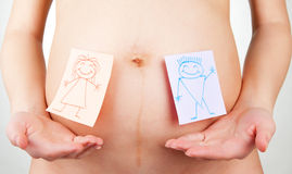 Paper stickers on pregnant woman abdomen Royalty Free Stock Photos