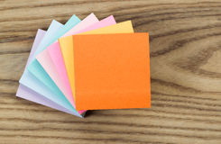 Paper Sticky Pad Notes on Aged Wood Royalty Free Stock Photos