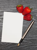Paper and strawberries Royalty Free Stock Image