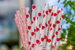 Paper straws for birthday party on natural background Stock Photos