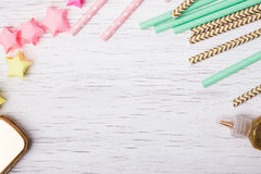 Paper straws and colorful stars Stock Photos
