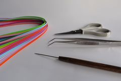 Paper Strips and Quilling Tools on White Background Stock Photo