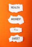 Paper symbols. On the orange Royalty Free Stock Photography