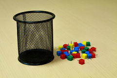 Paper tack and black basket on the wood background. Stock Photo