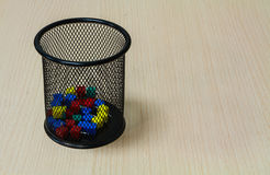 Paper tack in black basket on the wood background. Stock Photography