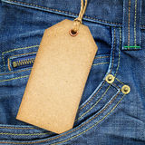 Paper tag on blue denim Royalty Free Stock Photo