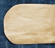 Paper tag on blue denim jeans Stock Images