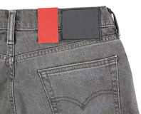 Paper tag on jeans Stock Image