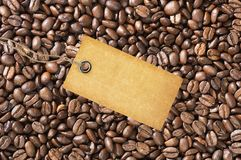 Paper tag over coffee beans Stock Images
