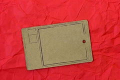 Paper tag on red crumpled paper background Royalty Free Stock Photos