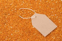Paper tag on red millet.  royalty free stock photos