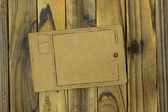 Paper tag on wooden background. Brown paper price tag on wooden background Stock Photography
